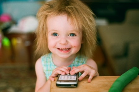 Gianna and one of her favorite toys, a cell phone.